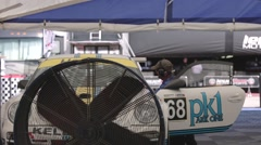 Race car in workshop Stock Footage