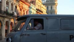 Police Van, crosses frame in Old Havana street, Cuba Stock Footage