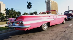 Stock Video Footage of Pink 1958 Chevy Impala convertible drives off, Havana, Cuba