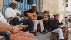 Cuban Musician's group in street in Old Havana with sound Stock Footage
