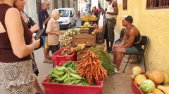 Vegetable street market in Havana, Cub, dolly back Stock Footage