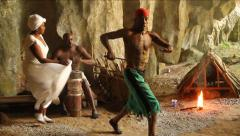 Santeria ritual, blacks playing drums, with machete and dancing in cave in Cuba Stock Footage