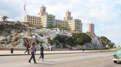 Malecon, Hotel Nacional,Havana, Cuba light traffic and pedestrians crossing Stock Footage
