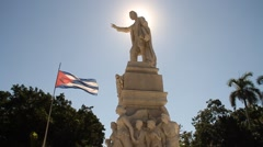 Jose Marti statue at Havana's Central Park, Old Havana with sun flare Stock Footage