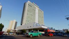 Havana Libre Hotel with traffic, Havana, Cuba Stock Footage