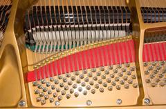 Inside baby grand piano Stock Photos