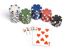three of a kind poker hand with colored poker chips. - stock photo