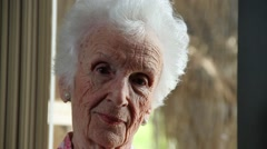 Close Up of very old lady looking at camera with different expressioms Stock Footage