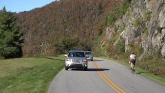 Cars and cyclist drive along blue ridge parkway road in the fall, asheville, Stock Footage