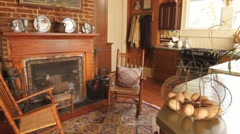 Cozy room with fire place decorated with antiques, colonial style Stock Footage
