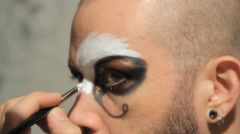 Man applying fantasy makeup for Halloween Stock Footage
