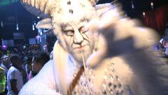 Man in White Faun costume trows glitter to camera in Discotheque Stock Footage