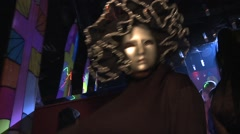 Silver Mask costume person dances in Discotheque to camera Stock Footage