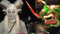 Moster and White Faun costumes dance at Halloween Stock Footage