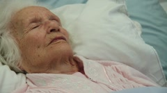 Close Up of Old lady dead in bed a sheet is put over her head. Dolly shot Stock Footage