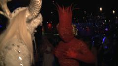 Man in White Faun costume dances with a costume  of Lady Gaga in Discotheque - stock footage