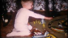 1557 - little boy plays with toys on Christmas morning - vintage film home movie Stock Footage