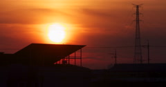 Sunset over the house at high voltage tower Stock Footage