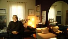 Panning to an elegant older gentleman In an eclectic decorated room Stock Footage