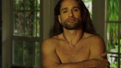 Shirtless Male Long Hair Looks and flirts to camera Stock Footage