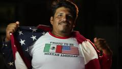 Latino,man opens up American flag shirt to reveal Mexican American t-shirt Stock Footage