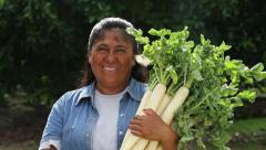 Hispanic, Latino,woman holds vegetables and smiles to camera with butterfly Stock Footage