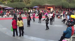 Middle aged women dance at people's park in Chengdu, China Stock Footage