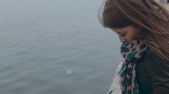Feminine girl sitting at berth near the sea and drawing anchor in pencil Stock Footage