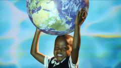 Black child holds up Globe of Planet Earth, water ripples in Back Ground Stock Footage