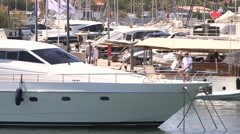 MAN ON BOW OF ST TROPEZ YACHT Stock Footage