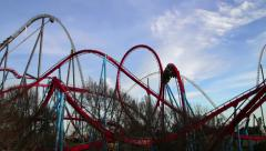 Huge Roller Coasters at an Amusement Park Stock Footage
