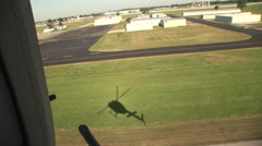 Kiowa OH-58 lands at a fuel stop Stock Footage