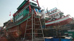 Stock Video Footage  Thai worker docker repairing boat Stock Footage
