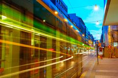 Tram departs from a stop on street Aleksanterinkatu in Helsinki - stock photo