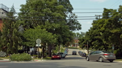 Driving plate: Mid West 1920s-30s neighborhood, rear view 1 4K Stock Footage