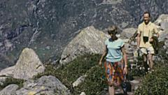 Italy 1968: people walking in a mountain trail - stock footage