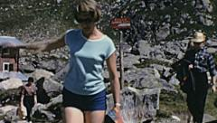 Italy 1968: people walking in the Alps Stock Footage