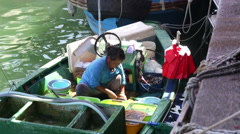 Sai kung Hong kong cutting fish on a small boat Stock Footage