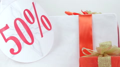 Christmas red white gift boxes with fifty percent sale discount sign Stock Footage