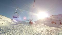 Pan shot ski slope into perfect sun Stock Footage
