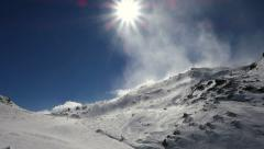 Gusting winds on ski slopes Stock Footage
