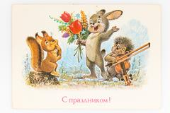 Reproduction of antique postcard shows squirrel, rabbit and hedg Stock Photos