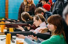 Unrecognizable Belarusian secondary school pupils girls shooting Stock Photos