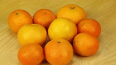 Tangerines rotates on a wooden boards background Stock Footage