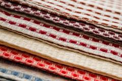 red, blue, brown, yellow white square checked kitchen napkins - stock photo