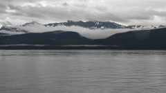 Boat ride on alaskan lake 03, snow-capped mountain in view. Stock Footage