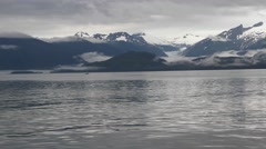 Boat ride on alaskan lake 06, snow-capped mountains in view Stock Footage