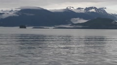 Boat ride on alaskan lake 07, snow-capped mountains in view Stock Footage