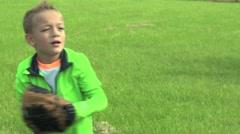 CU boy catch and throw baseball Stock Footage
