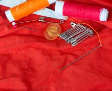sewing equipment representing text space and needles - stock photo